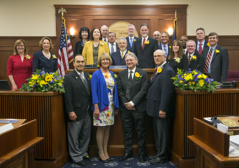 Alaska State Senate first day of 30th Legislature. Senators taking oath of office. Senate family photos and staff.