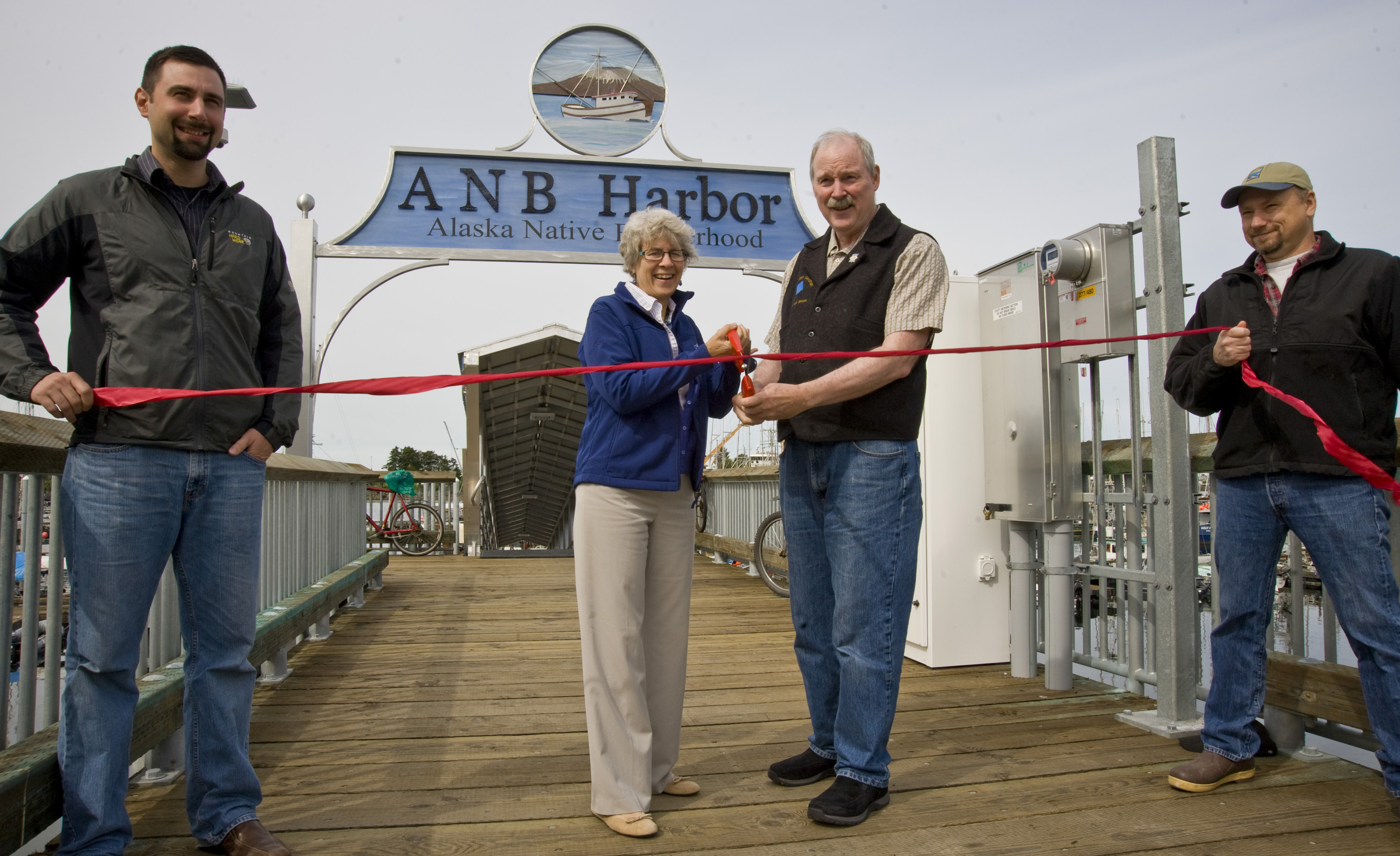 City Engineer Dan Tadic, Mayor Mim McConnell, Senator Stedman and Harbormaster Stan Eliason cut the ribbon at the new ANB Harbor (photo courtesy of James Poulson, Sitka Sentinel)