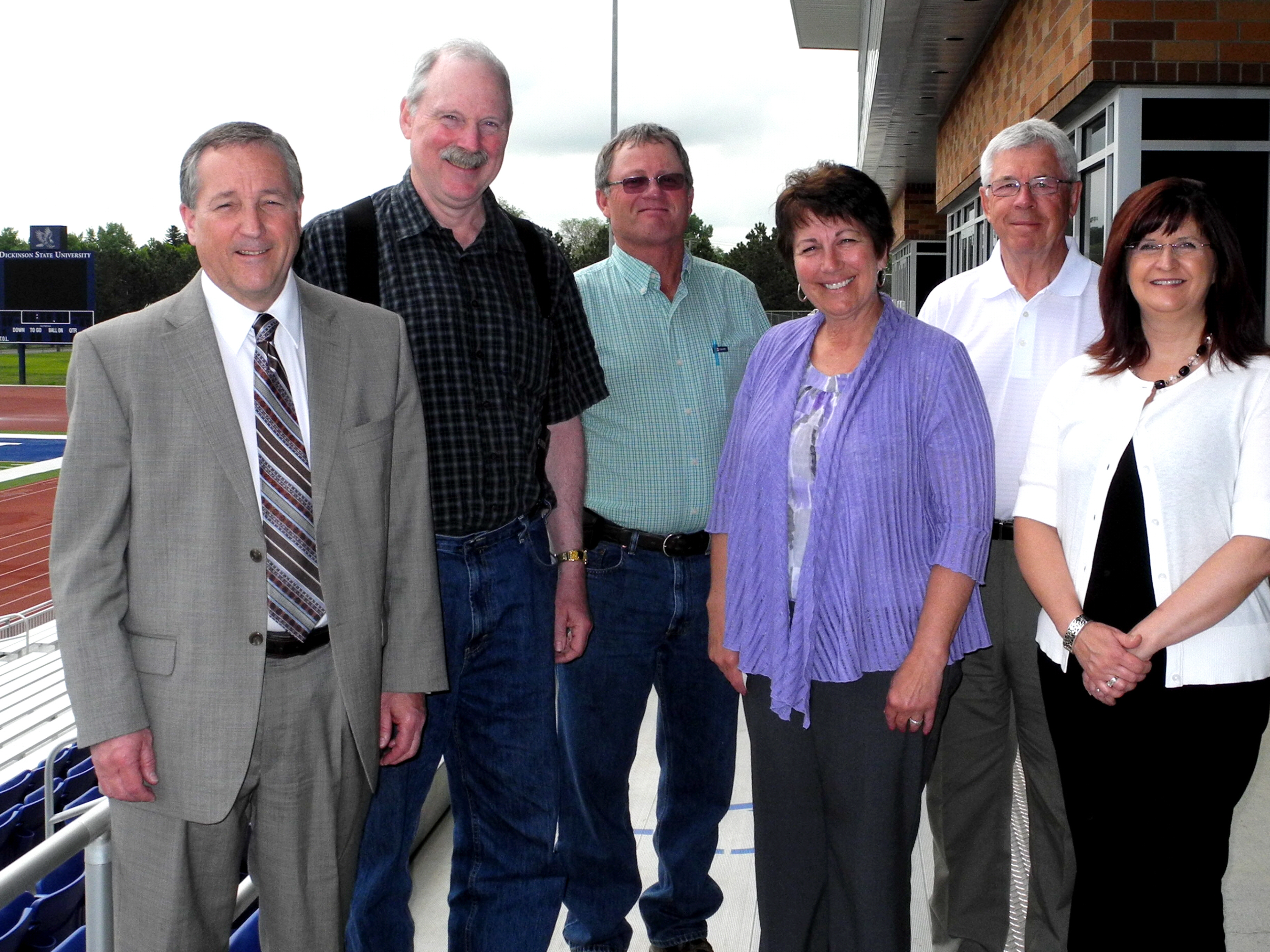 Alaska Senator Bert Stedman, Chairman of The Energy Council, thanks officials from Dickinson, North Dakota, who briefed members of the Council's Executive Committee on impacts to their city and region from Bakken oil development. From left to right are Dickinson Mayor Dennis Johnson; Senator Stedman; Mr. Al Heiser, Stark County Road Superintendent; North Dakota Representative Vicky Steiner; North Dakota Senator Rich Wardner; and Ms. Melanie Kathrein of the Dickinson Public School District.