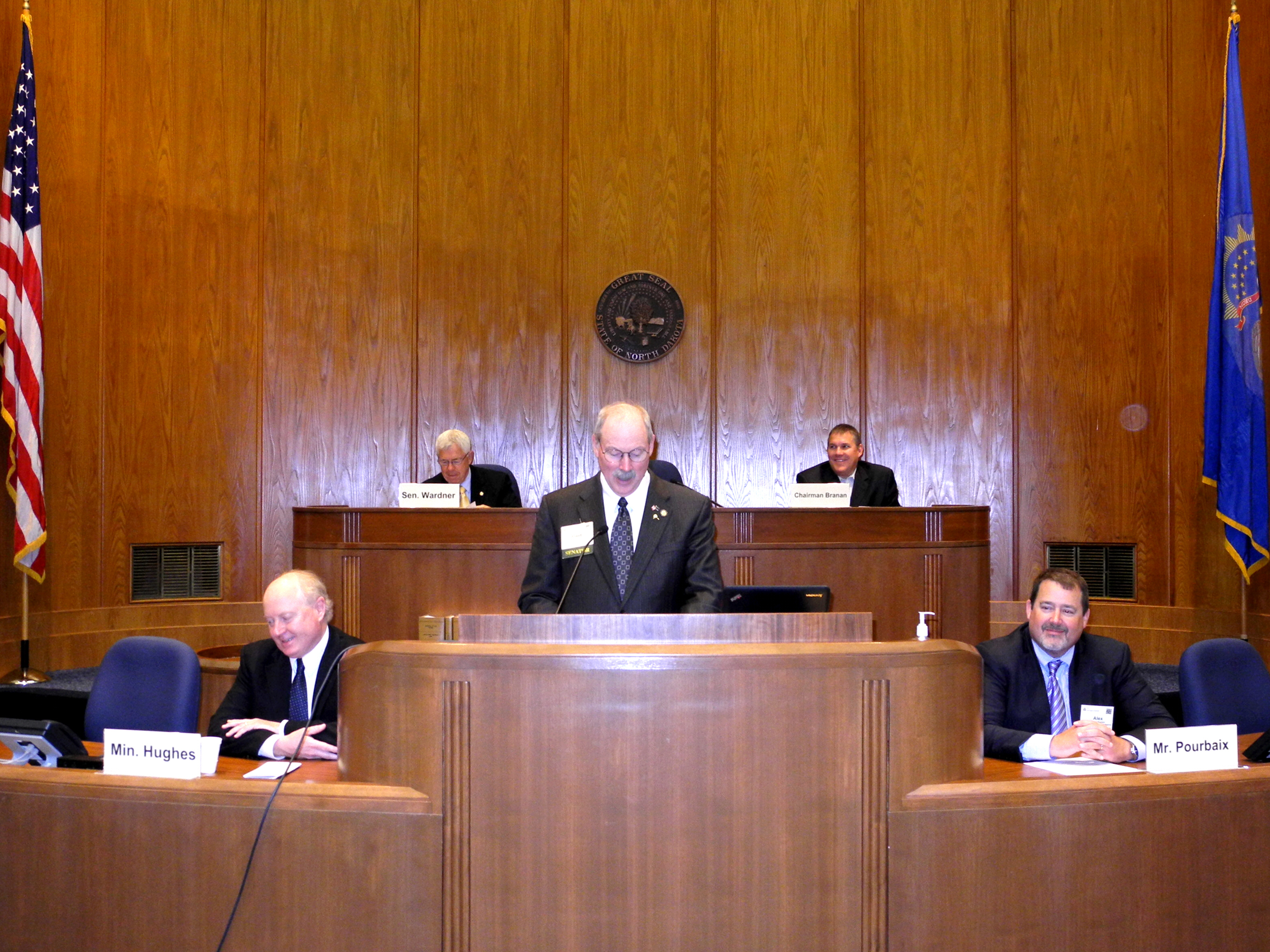 Alaska Senator Bert Stedman presides over the Energy Council's 2013 State and Provincial Trends in Energy and the Environment Conference General Session on Friday, June 21, in the North Dakota State Capitol.  Senator Stedman introduced the Alberta Minister of Energy, the Honourable Ken Hughes (far left) and Mr. Alex Pourbaix, President of TransCanada Energy and Oil Pipelines (far right), both of whom addressed the conferees.  Seated behind Senator Stedman are North Dakota Senator Rich Wardner, Energy Council Vice President for State and Provincial Trends (left) and Oklahoma Senator Cliff Branan, Chairman of the Center for Legislative Energy and Environmental Research (right).