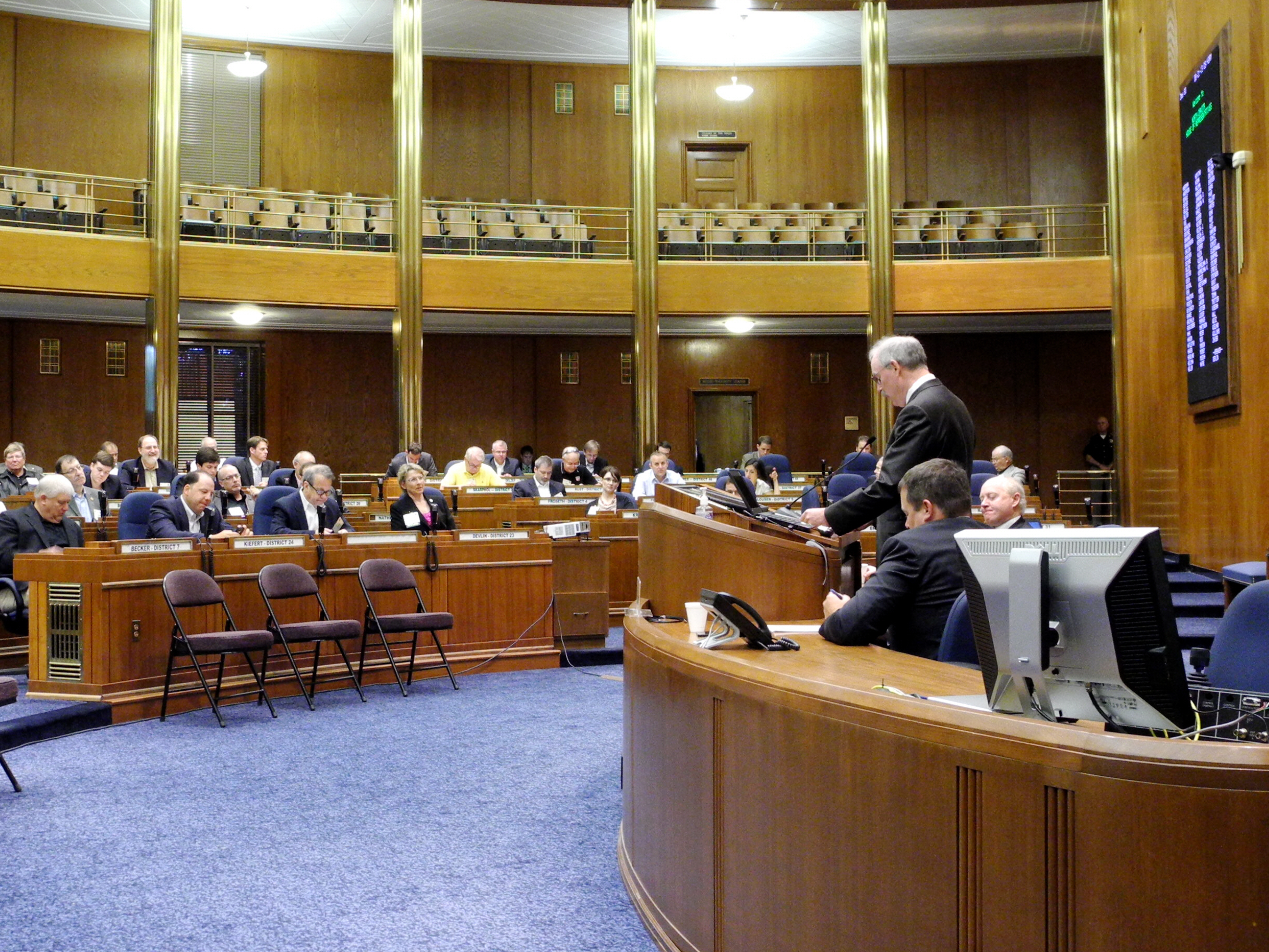 Alaska Senator Bert Stedman presides over the Energy Council's 2013 State and Provincial Trends in Energy and the Environment Conference, held in the North Dakota House of Representatives Chamber, in the State Capitol, on June 21.
