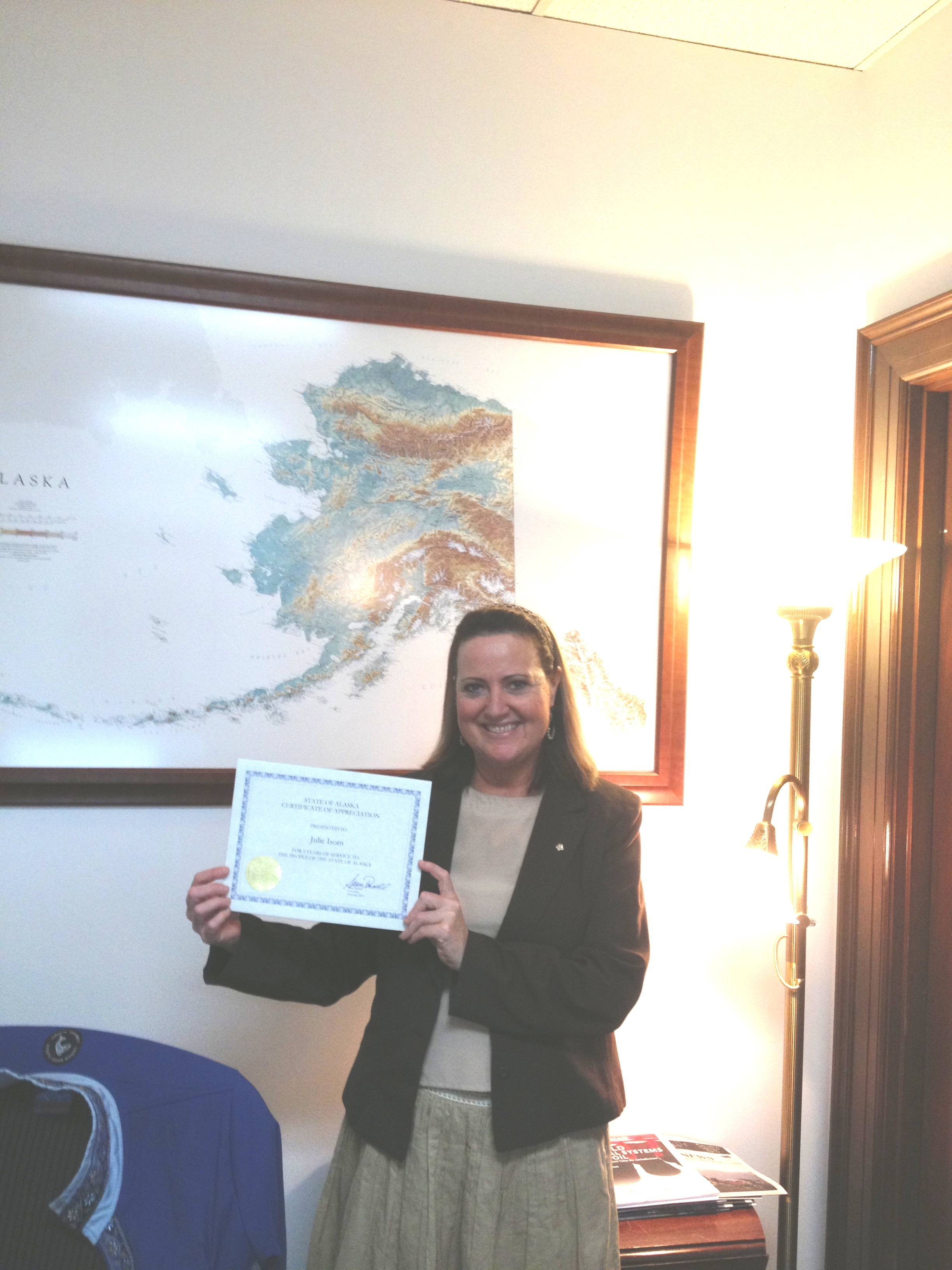 Julie Isom with her certificate honoring 5 years of state service
