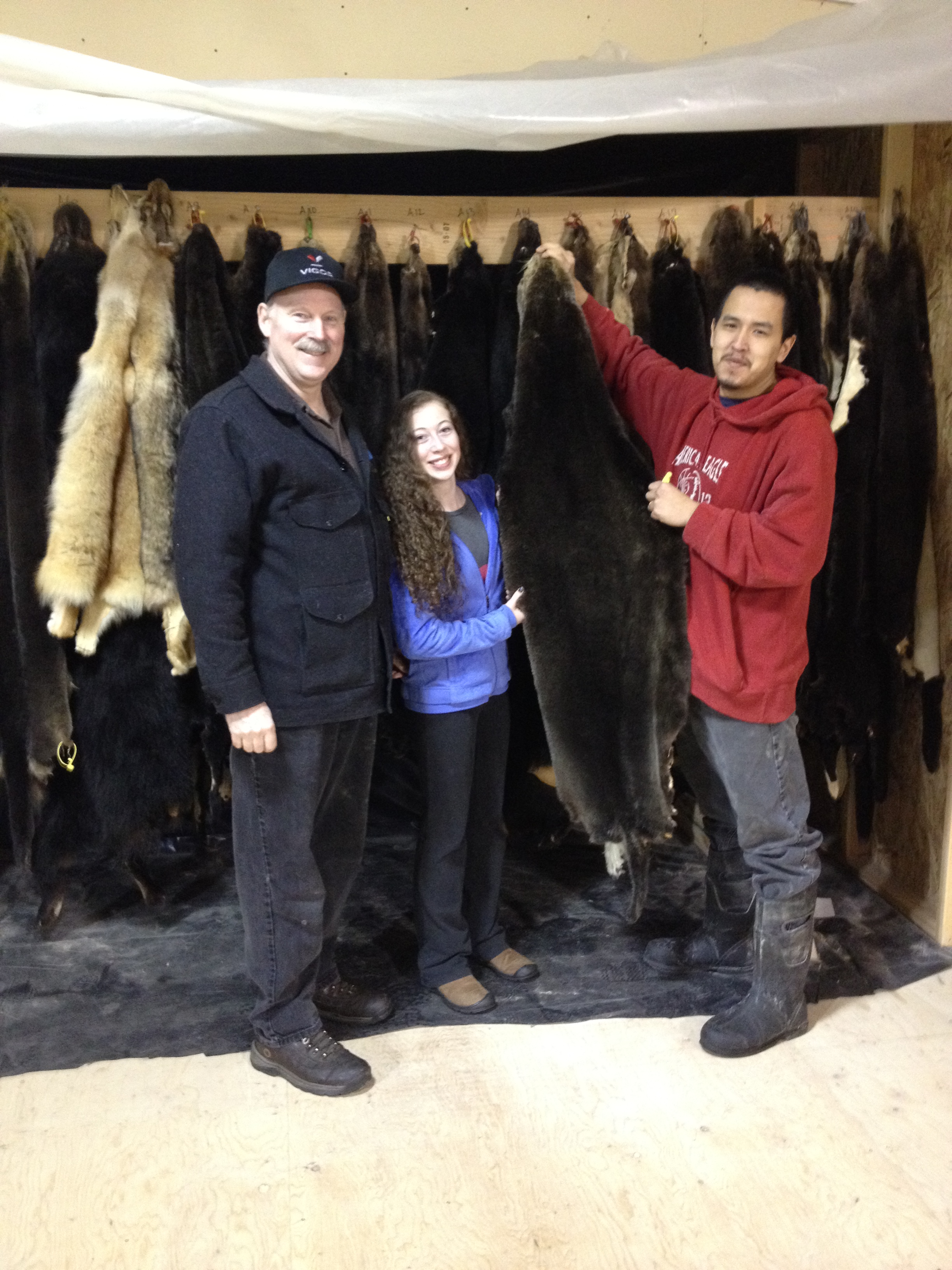Russell James gives Senator Stedman and his daughter a tour of the Sitka Tribes tannery