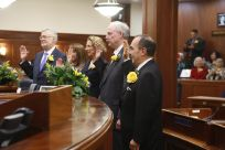 Alaska State Senate first day of 30th Legislature. Senators taking oath of office. Senate family photos and staff.